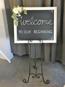 white welcome sign with easel